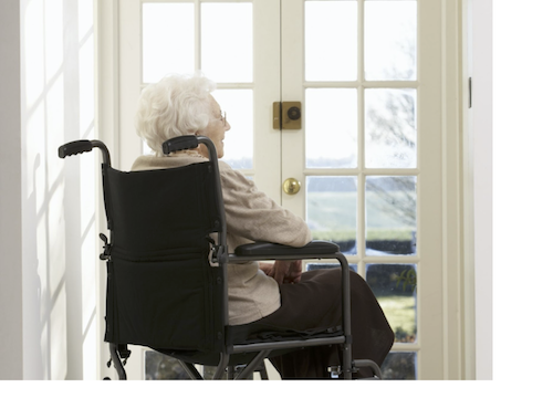 woman in nursing home looking outside