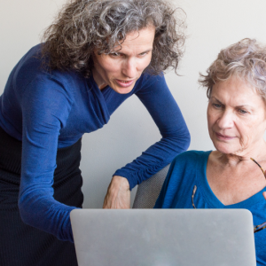 mom with dementia, daughter helping with paperwork
