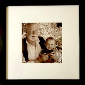 Grandpa holding grandson