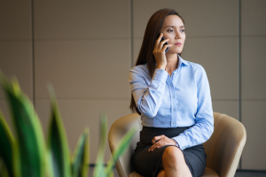 woman on phone looking worried